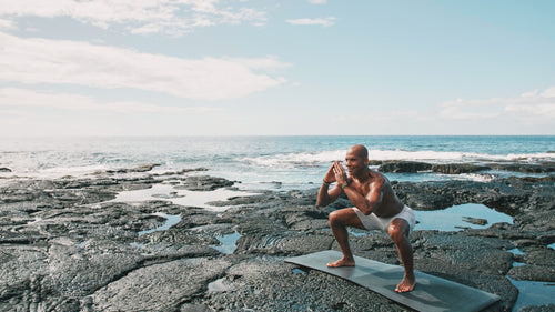 @kupahjames working out along the black volcanic rock on the Big Island of Hawaii.