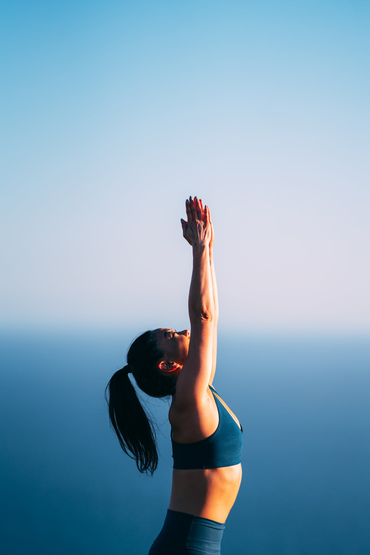Woman practicing Mountain Pose in an open-air space.