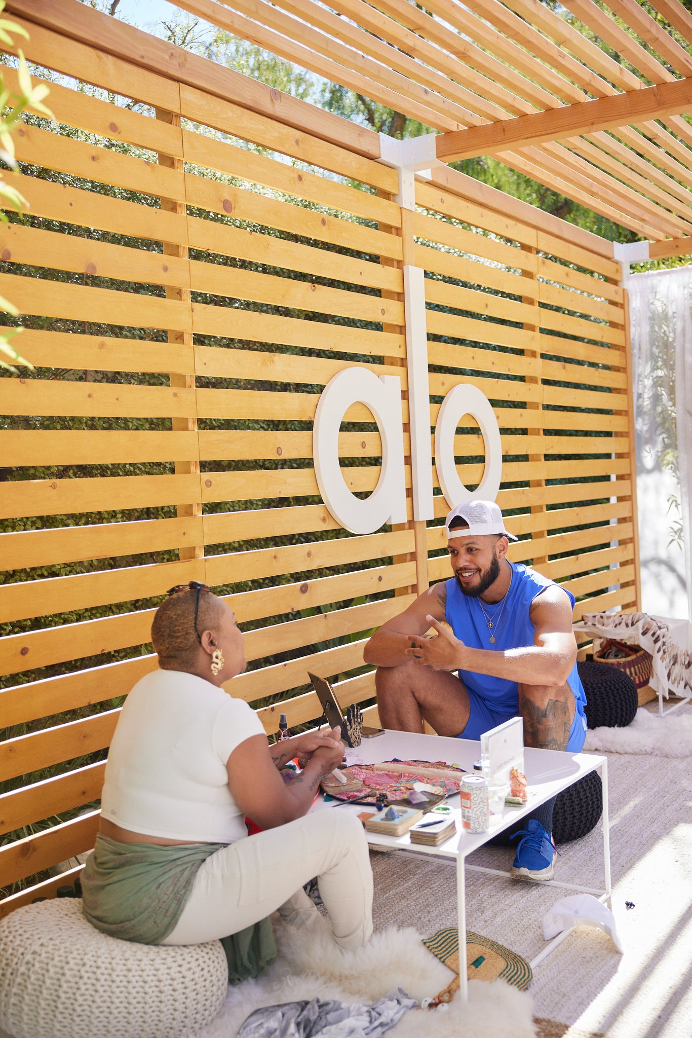 A man participating in a wellness activity within the Mindful Masters cabanas.