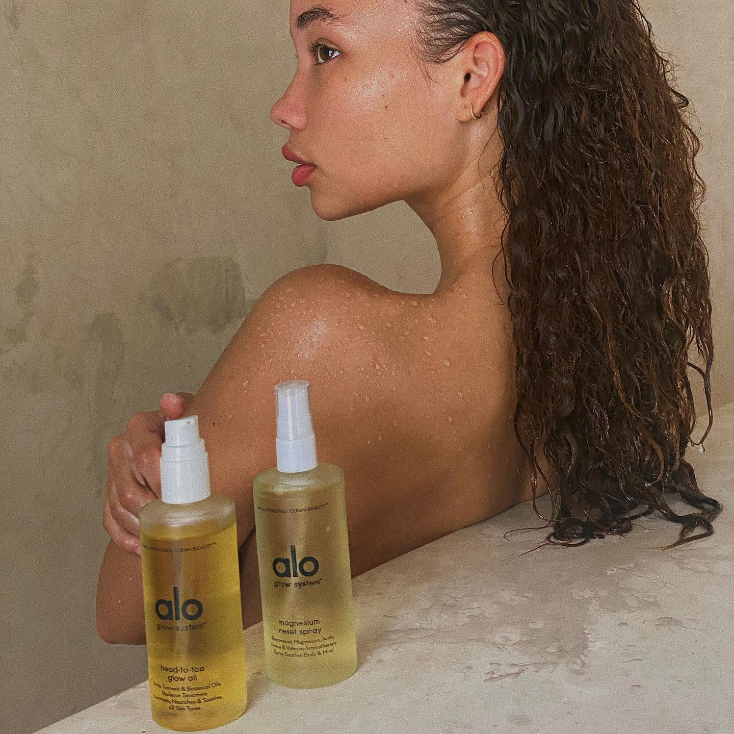 @ashley_moore_ enjoying her Magnesium Reset Spray and Head-To-Toe Glow Oil pre- and post-shower.