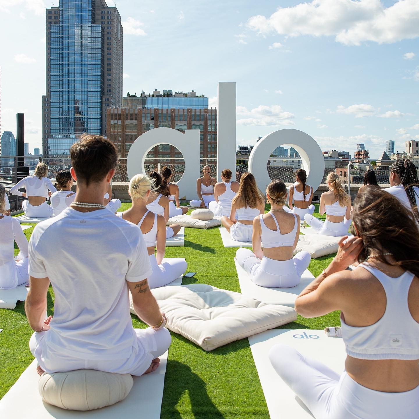 An epic yoga flow on the rooftop of the Alo Flat Iron Sanctuary during New York Fashion Week.