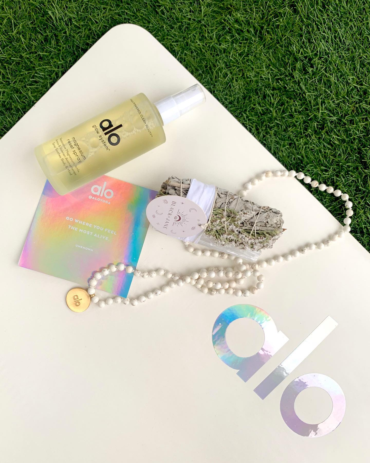 A gift set with the Magnesium Spray, mala beads, and a sage bundle for yoga class attendees.
