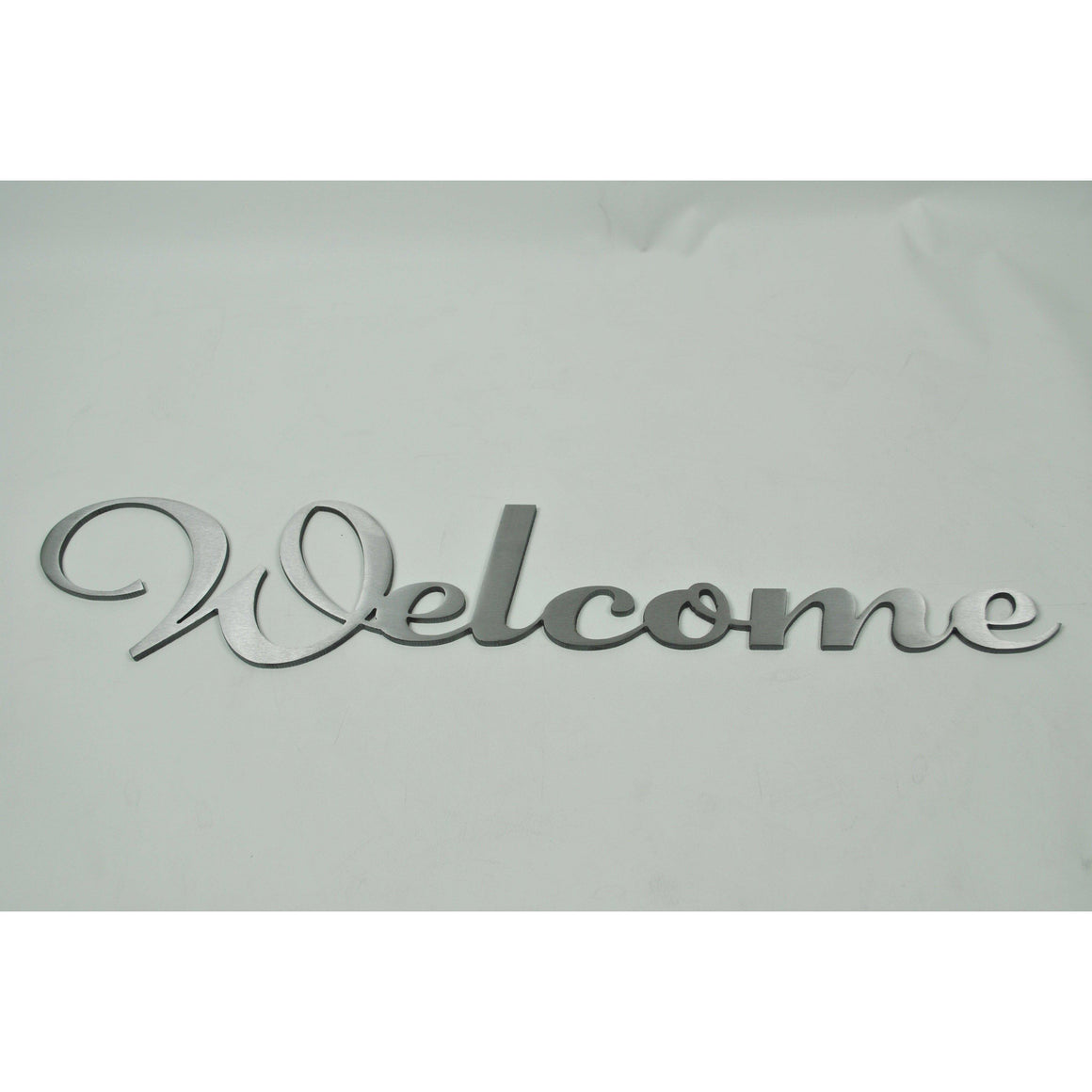 Welcome sign in stainless steel