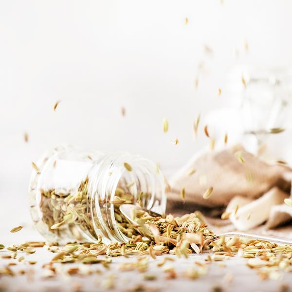 A small pile of fennel seeds on a table