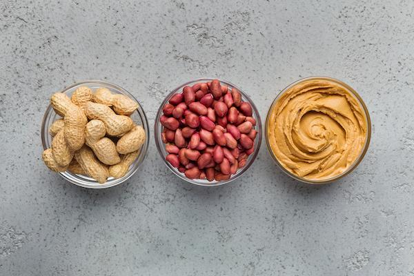 3 bowls with peanuts and peanut butter