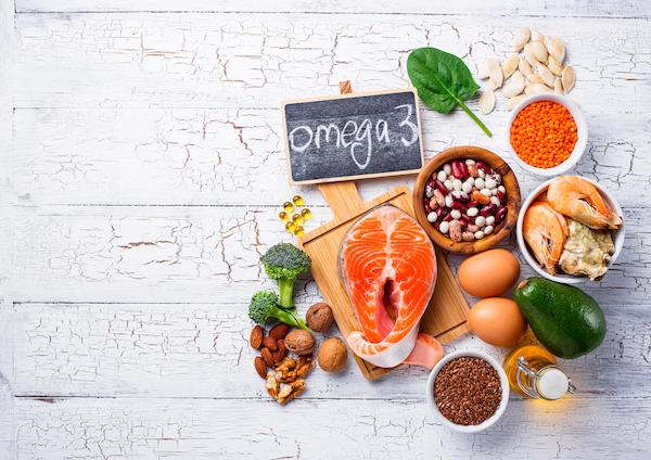Various food sources of omega-3 on a white background