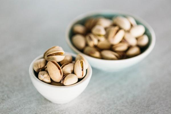 2 small bowls of shelled pistachio nuts