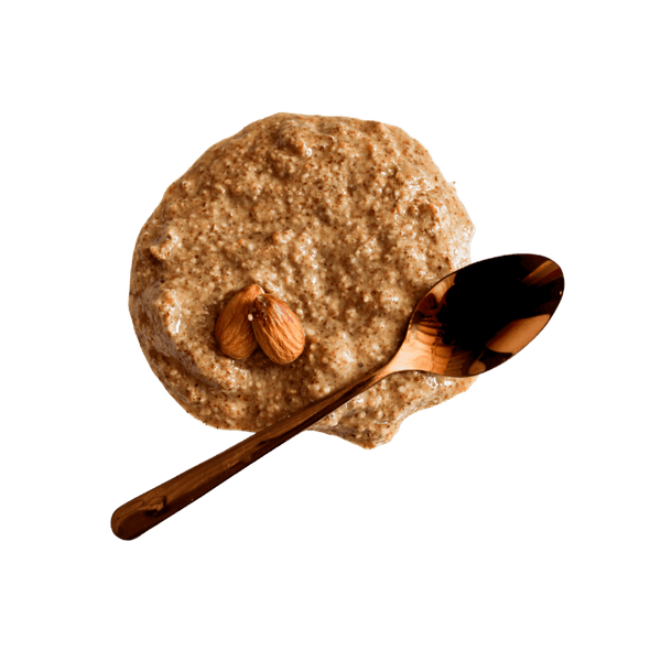 Dollop of Almond Butter with two whole almonds and copper teaspoon.