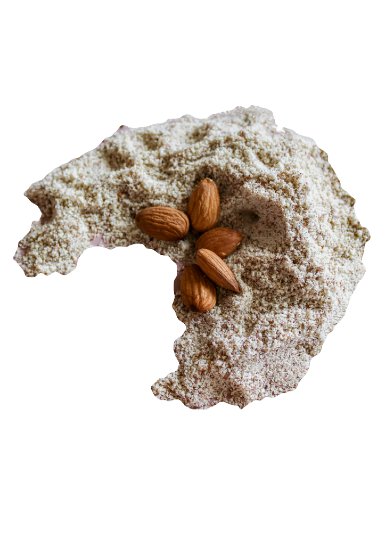 Moon shaped pile of Almond Flour with five whole raw almonds.