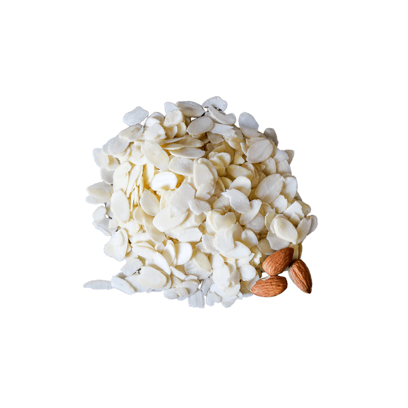 Neat pile of Blanched Almonds Flakes with three whole raw almonds.