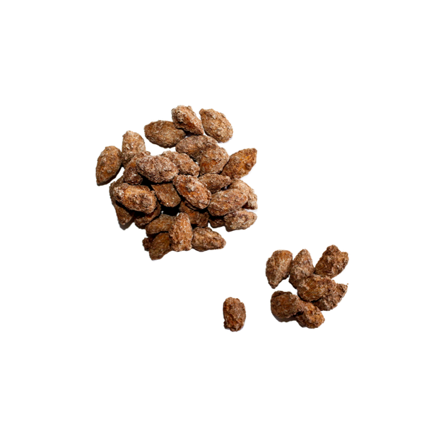 Scattered pile of Cinnamon Almonds.