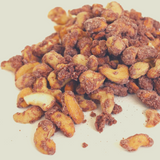 Close up of a pile of Cinnamon Roasted Cashews.