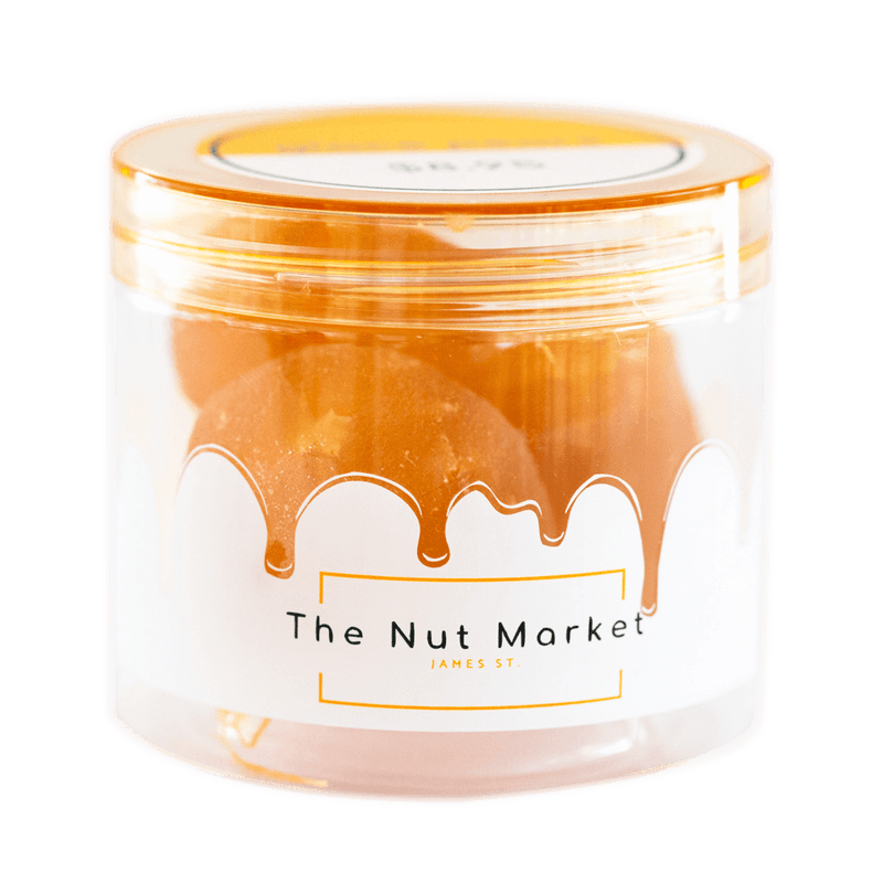 Side on view of Nut Market jar with Glace Apricots inside.