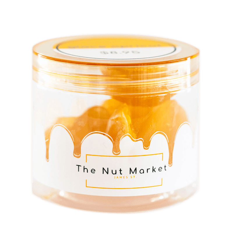 Side on view of Nut Market jar with Glace Peaches inside.