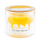 Side on view of Nut Market jar with Glace Pineapple inside.