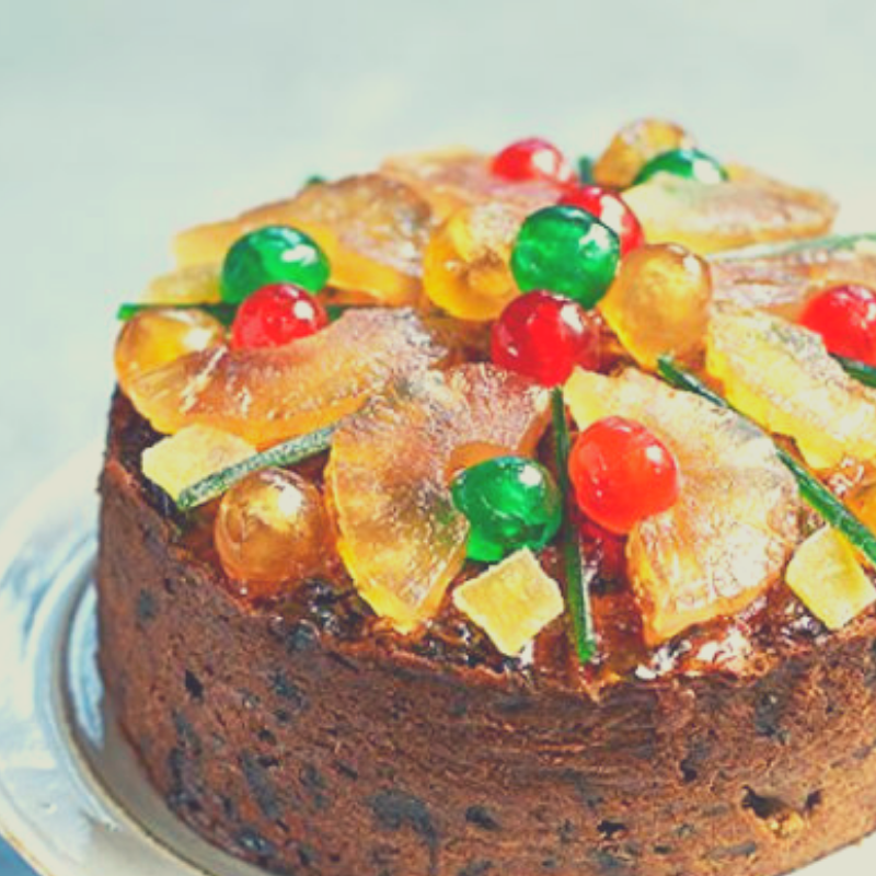 Fruit Cake/ Christmas Cake decorated with Glace Pineapple and Glace Cherries.