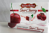 Hazer Baba Sour Cherry Turkish Delight Gift Boxes stacked together on concrete background.