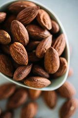 Close up of Dry Roasted Almonds in small bowl.