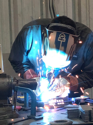 Welding products with welding hood on