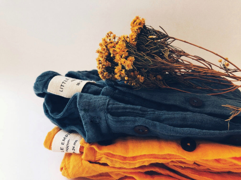 folded clothes layered with flower