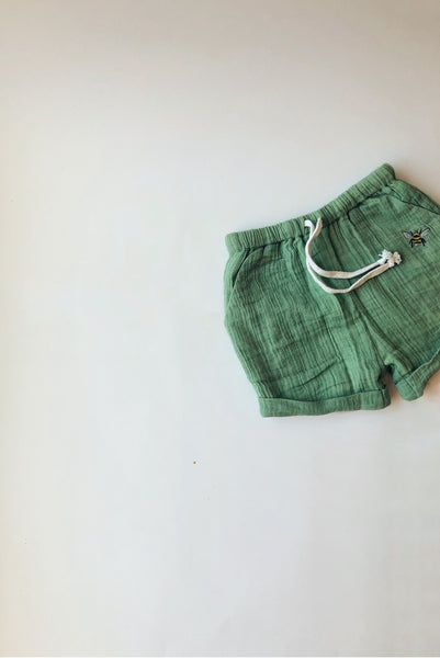 green boy and girl shorts with side pockets and bee embroidery