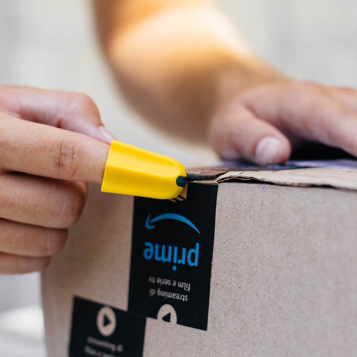 image of finger Safety cutter cutting a package