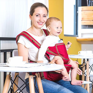 image of parent using  baby hipseat carrier