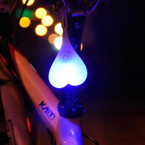 Image of glowing bike balls hanging to the bike