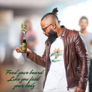 Man with Beard hold bottle of Magnolia's Hair beard & skin oil Captioned Feed your beard like you feed your body