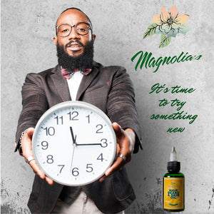 Man with beard holding clock Magnolias hair beard & skin oil captioned its time to try something new