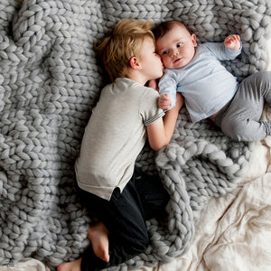 Soft, luxurious chunky knit baby blanket by The Flying Lamb. Handmade from 100% premium Australian Merino wool, hand knitted on the Mornington Peninsula Australia. Let's get cosy ...