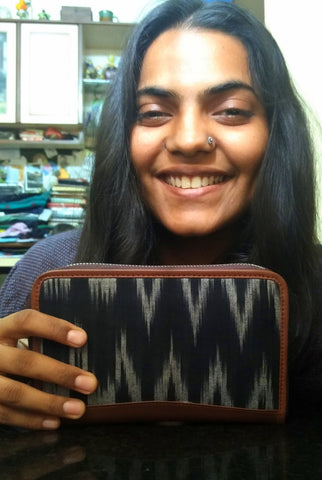 Trishna holding out her Zouk Ikat Wave wallet