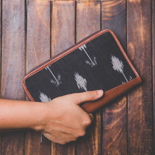 Zouk Ikat Arrow Chain Wallet - Model holding the Wallet in the hand view