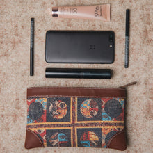 Load image into Gallery viewer, Zouk African Art Multipurpose Pouch - Front View with items in front of it for reference, Jute Khadi Fabric, Vegan Leather