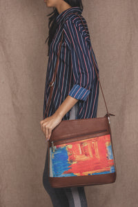 Zouk Abstract Amaze Bucket or Sling Bag - Model holding the bag on shoulder image