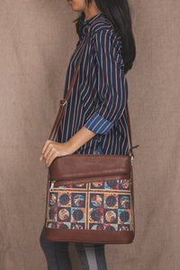 Zouk African Art Bucket or Sling Bag - Model carrying the bag on shoulder view
