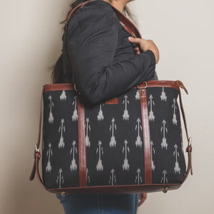 Zouk Ikat Arrow Women's Office Bag - Model holding the bag on shoulder side view