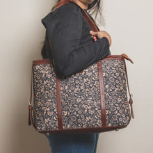 Load image into Gallery viewer, Zouk FloMotif Women's Office and Laptop bag - Model carrying the bag on shoulder side view