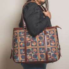 Load image into Gallery viewer, Zouk African Art Women's Office Bag - Model carrying the bag in shoulder image