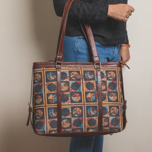 Zouk African Art Women's Office Bag - Model holding the bag in hand view