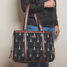Load image into Gallery viewer, Zouk Ikat Arrow Women's Office Bag - Model holding the bag in hand front side view