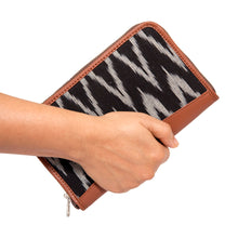 Zouk Ikat Wave Chain Wallet -Model holding the wallet view