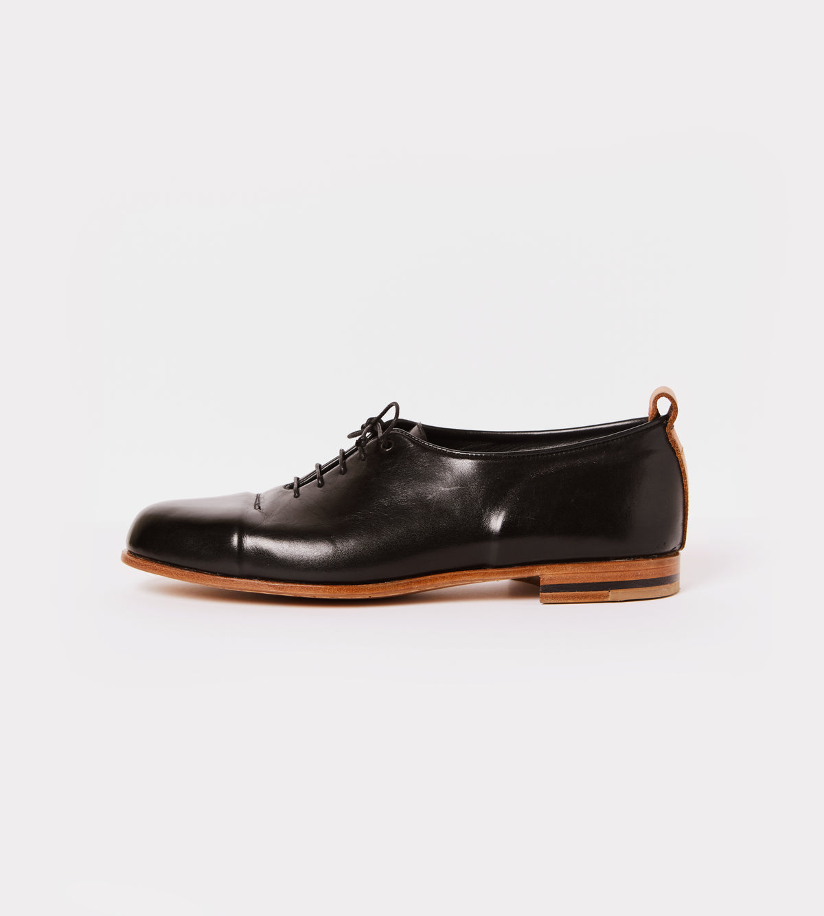 Black calf leather wholecut shoe outside view