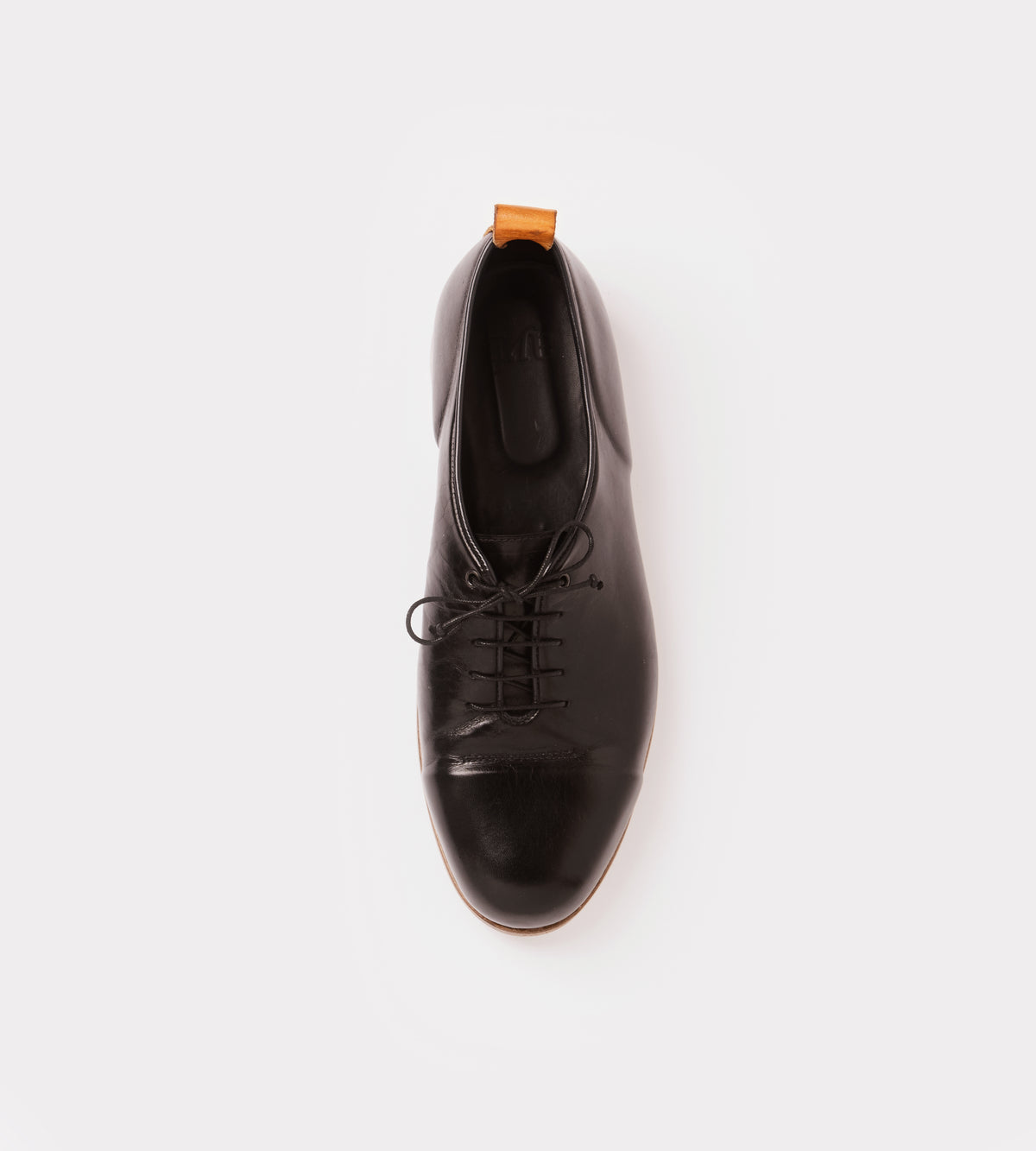 Black calf leather wholecut shoe top view