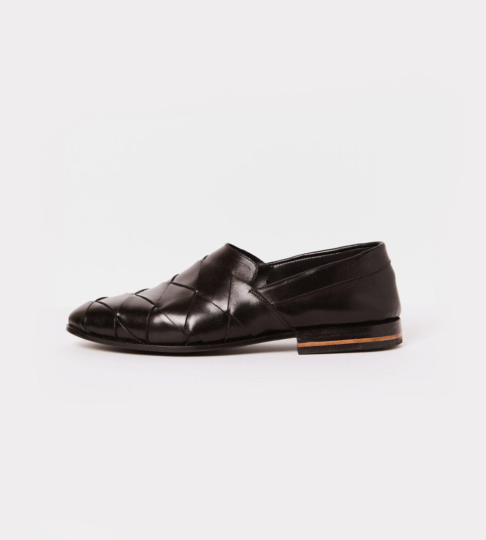 Black hand woven calf leather slip on outside view