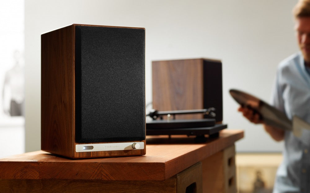 Audioengine HD6 Powered Speakers - Walnut on table