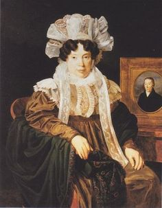 Mrs. Kritter-Babics with a Portrait of Her Late Husband