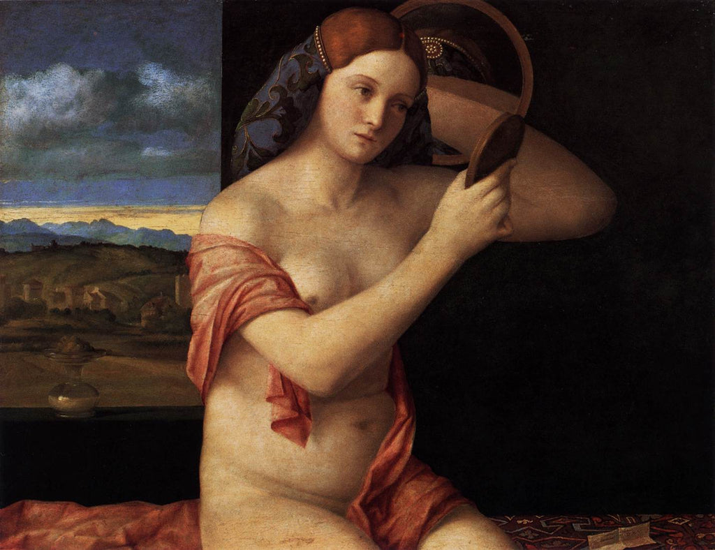 Naked young woman in front of the mirror