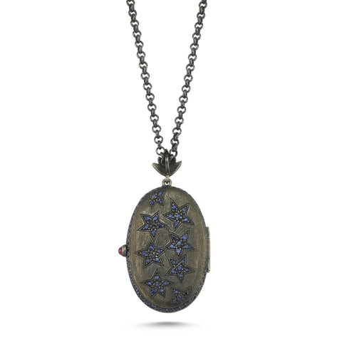 Deep Blue Dove Locket. 18K Yellow Gold and oxidized silver with 0,40ct diamonds, 15.01ct blue sapphires, 0,30ct rubies. Chain: Oxidised silver