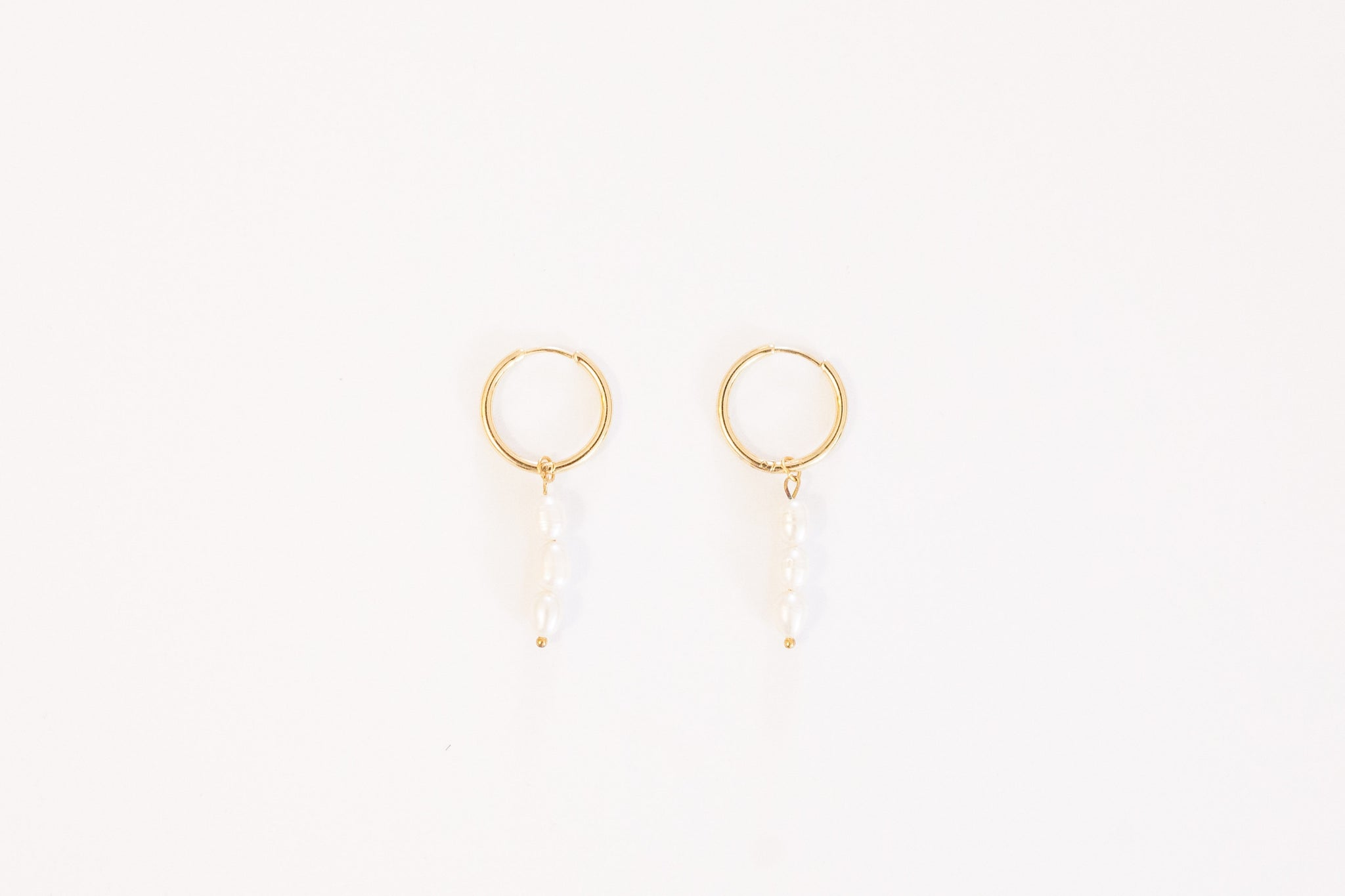 pearl earrings on white background
